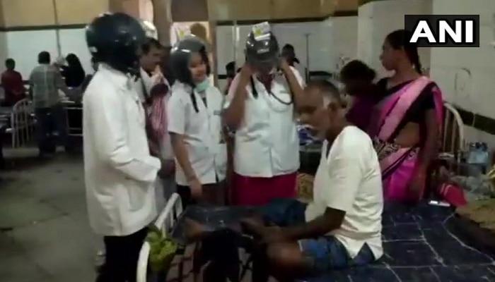 హైదరాబాదులో హెల్మెట్ పెట్టుకొని వైద్యం చేసిన డాక్టర్లు